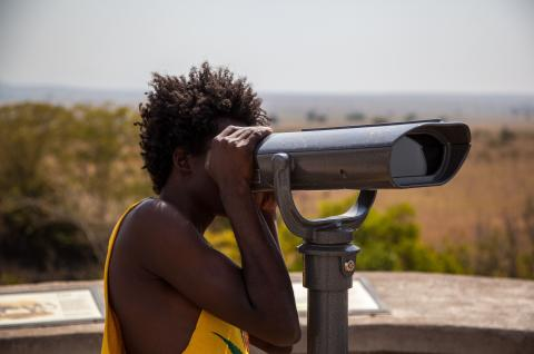 Woman looking through Telescope_Uganda
