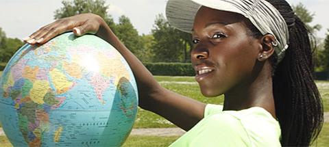 Black woman with globe